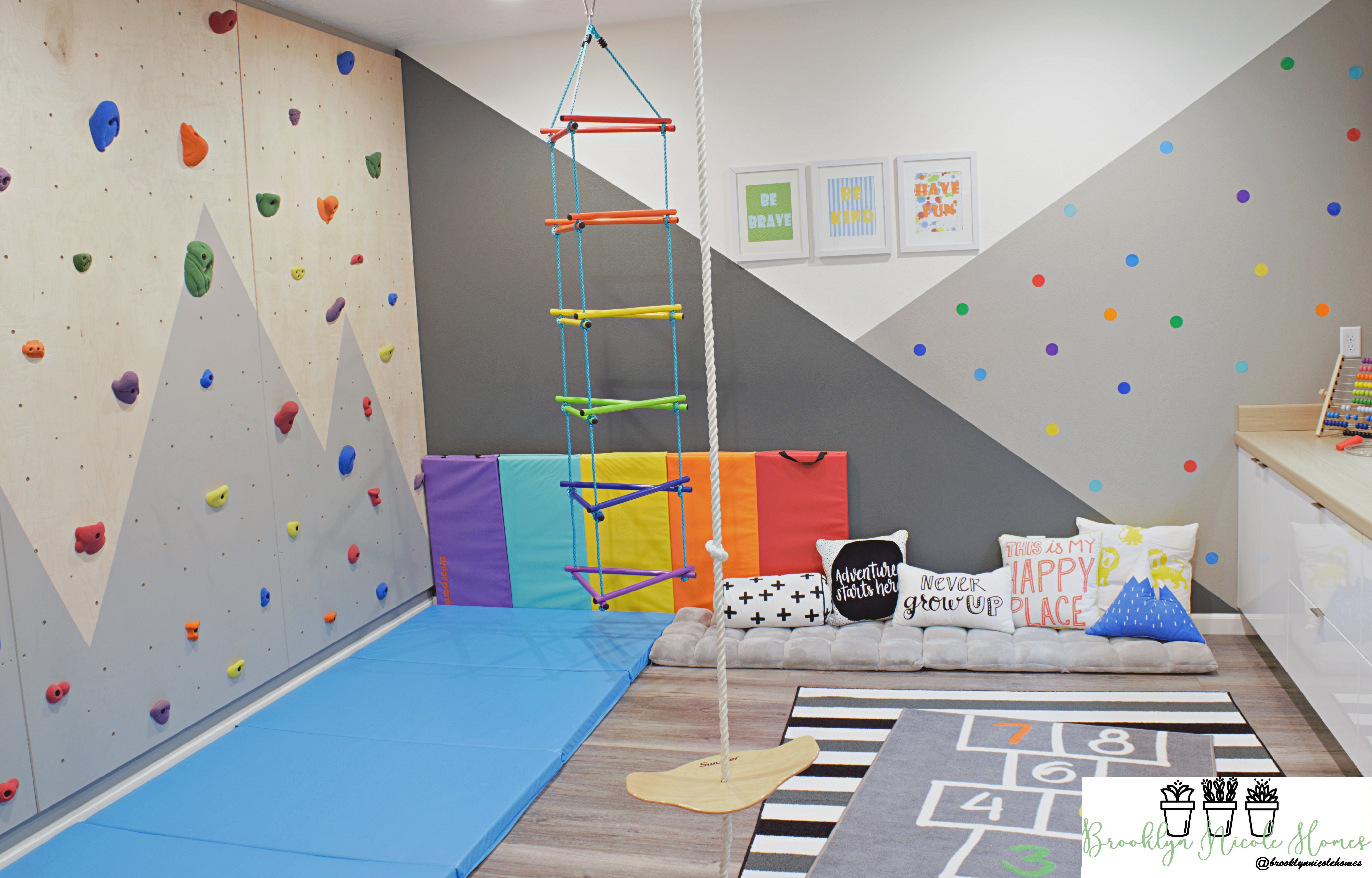 A Fun And Colorful Playroom With Indoor Climbing Wall, Swing
