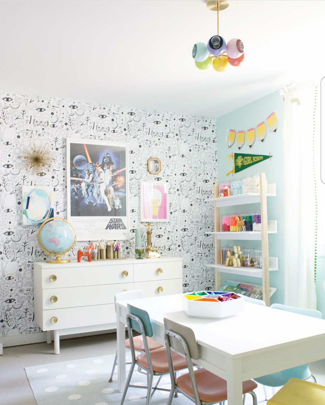 Pastel Colored Children's Playroom Design With A Rainbow